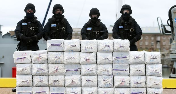 Members of the Irish Navy standing behind 1,025                   kgs of cocaine worth €290 million discovered on board                   the Makayabella off the Cork coast in September, 2014.                   File Photograph: Brian Lawless/PA Wire