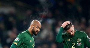 Ireland's David McGoldrick and Matt Doherty dejected after the EUro 2020 qualifier against Denmark last November. Photo: James Crombie/Inpho
