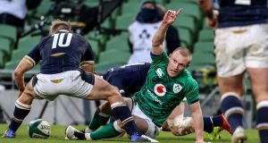 Keith Earls celebrates after scoring Ireland's opening try in the Autumn Nations Cup third-place playoff against Scotland at the Aviva Stadium. Photograph: Dan Sheridan/Inpho