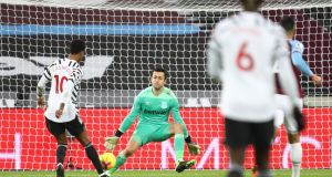 Manchester United's Marcus Rashford chips the goalkeeper for the third goal of the game in their win over West Ham. Photo: Julian Finney/EPA