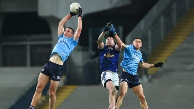 Dublin's Brian Fenton claims the ball as team-mate Davy Byrne and Pádraig Faulkner of Cavan also contest during the All-Ireland SFC semi-final at Croke Park. Photograph: Tommy Dickson/Inpho