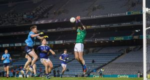 Dublin's Robbie McDaid fists home Dublin's goal past Cavan goalkeeper  Raymond Galligan during the  All-Ireland SFC semi-final at  Croke Park. Photograph: James Crombie/Inpho