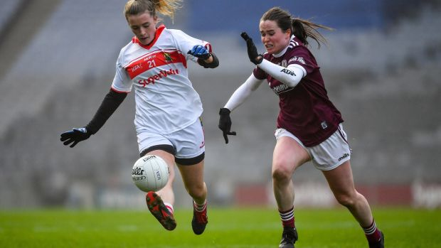 Cork's Daire Kiely solos away from Nicola Ward of Galway during the semi-final at Croke Park. Photograph: Ray McManus/Sportsfile