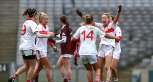 Cork players celebrate at the final whistle after their victory over Galway in the semi-finals of the TG4 All-Ireland Ladies' Senior Football Championship at Croke Park. Photograph: Bryan Keane/Inpho