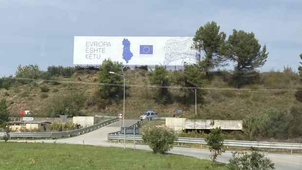 "Overlooking a roundabout outside the town of Rrogozhinë, in the country's Western Lowlands region, a massive EU billboard declares in Albanian ""Europe is here"". Photograph: Dan Griffin"