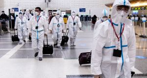 Airline crew members wear full hazmat suits as they arrive at LAX Tom Bradley International Airport in Los Angeles amid COVID-19 pandemic in Los Angeles last month. Photograph: Etienne Laurent/ EPA
