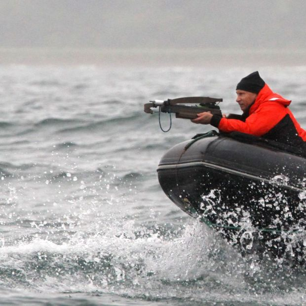 Vladimir Putin aims at a whale in 2010, when he was prime minister of Russia. Photograph: Alexey Druzhinin/AFP via Getty