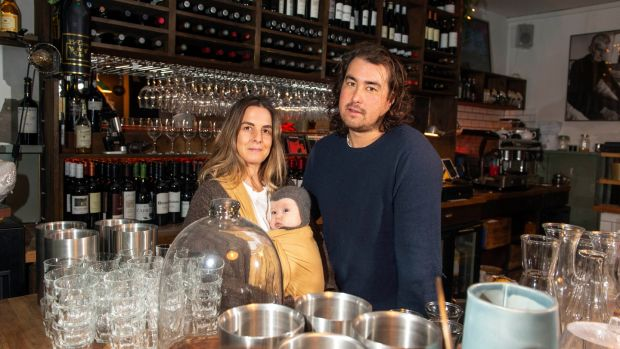 Siobhan Waldron, five-month old baby Cass and her husband Gavin Ryan, in their wine bar, The Black Pig, Kinsale, Co Cork. Photograph: Michael MacSweeney/Provision