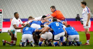 Referee Nigel Owens sorts out the France and Italy frontrows during  his 100th and final international at the Stade de France. Photograph: Dave Winter/Inpho