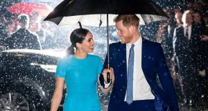 Prince Harry, Duke of Sussex and Meghan, Duchess of Sussex: took backseats as members of the British royal family. Photograph:  Samir Hussein/WireImage