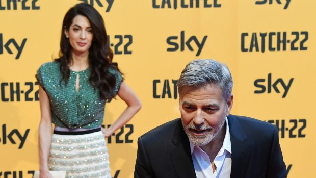 George Clooney with his wife, the human rights lawyer Amal Clooney. Photograph: Getty Images