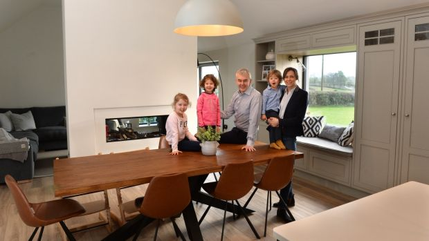 Inge and Declan Ronaghan, in their new home with children Lexie, Sienna and Matthew in Coolmuckbane, Co Monaghan. Photograph: Dara Mac Dónaill