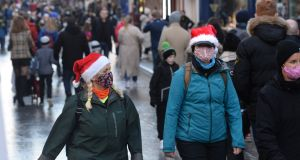 Grafton Street:  Christmas shoppers turn out in large numbers  on the first Saturday following the end of the second lockdown. Photograph: Dara Mac Dónaill