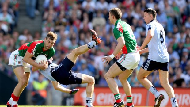 Mayo's Aidan O'Shea and Barry Moran with Eamon Fennell and Denis Bastick of Dublin. Photograph: James Crombie/Inpho
