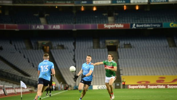 Con O'Callaghan passes to Paddy Small as Oisín Mullin tracks him during the All-Ireland SFC final between Mayo and Dublin. Photo: Dara Mac Donaill/The Irish Times