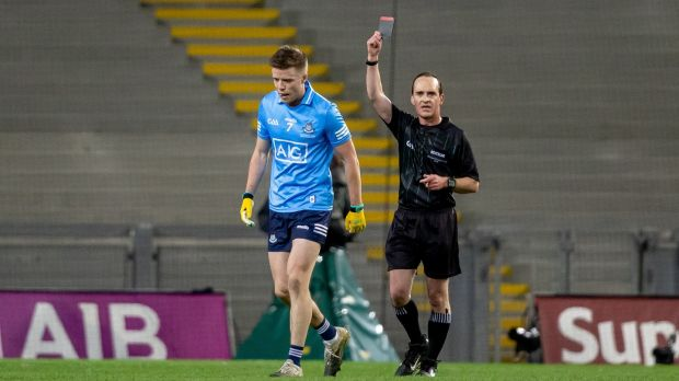 Referee David McGoldrick shows a black card to Dublin's Robbie McDaid just before half time. Photograph: Morgan Treacy/Inpho