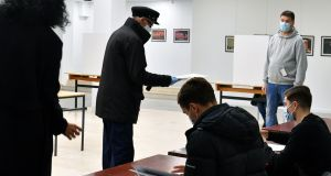 A man prepares to cast his vote for local elections in Mostar, southern Bosnia and Herzegovin, the first since 2008. Photograph: Elvis Barukcic