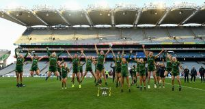 The Meath team celebrate with the Mary Quinn memorial Cup. Photograph: Sportsfile