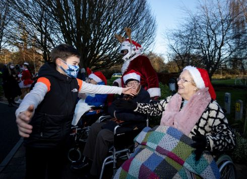 Nursing home residents  of Marymount Care Centre at the  Christmas Community Spirit  Campaign. Zach Nevin  (11) with his nanny Joan Byrne.  Photograph: Tom Honan/The Irish Times.