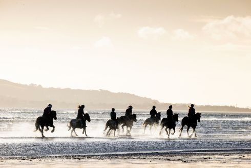 Members of the Corballis Farm Horse Trekking and Therapeutic Riding Centre on Donabate Beach, Co Dublin. Photograph: Tom Honan/The Irish Times.