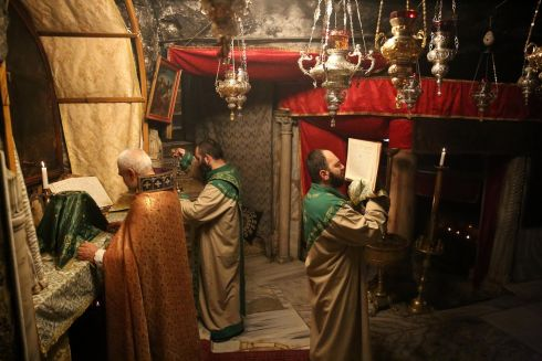 Priests at prayer during a Mass at the Holy Cave in the Church of Nativity in the West Bank town of Bethlehem. Photograph: Abed Al Hashlamoun/EPA
