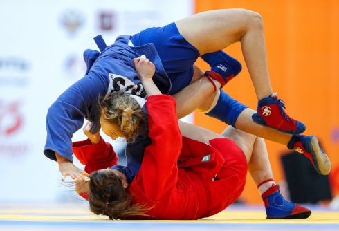 Elena Zaikina (blue) of Russia in action against Karyna Shut (red) of Belarus during their women's 80kg category final bout at the Sambo World Cup 2020 in Moscow. Zaikina won the competition.  Photograph: Sergei Ilnitsky/EPA