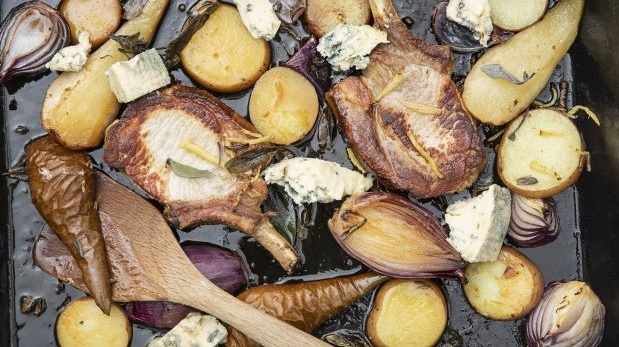 Pork chops with roasted pears, sage, onion and gorgonzola. Photograph: Harry Weir Photography