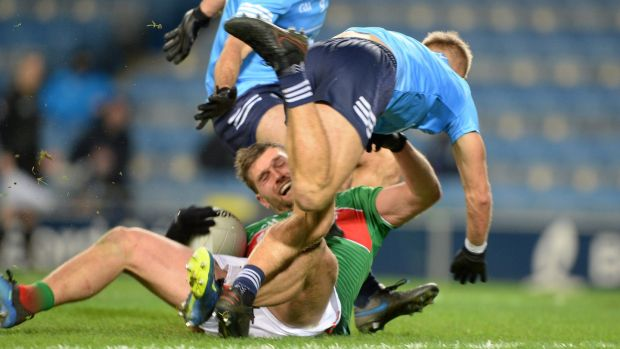 Johnny Cooper fouling Aidan O'Shea: Both in the semi-final and final the wily Cooper was caught isolated one-on-one and managed to foul his man without being sent to the sin-bin either time. Photograph: Dara MacDonaill/Inpho