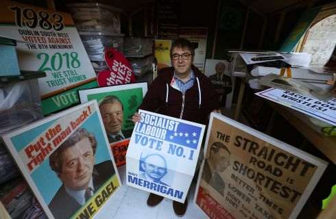 ELECTION HOARDING? Alan Kinsella, who has spent almost 40 years collecting election posters, referendum leaflets and political memorabilia, displays some of his collection at his home in Dublin. Photograph: Brian Lawless/PA Wire