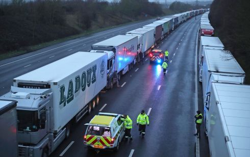 TERMINAL VELOCITY: Coast guard staff hand out bottles of water to lorry drivers parked on the M20 in Kent on Monday after the Port of Dover was closed when the French government announced it would not accept passengers arriving from the UK due to a more infectious strain of Covid-19. Photograph: Steve Parsons/PA Wire