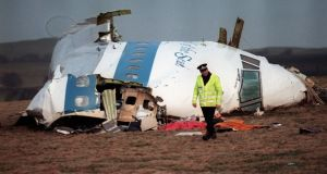 Photograph taken on December 22nd, 1988, shows a policeman walking away from the damaged cockpit of the 747 Pan Am flight that exploded and crashed over Lockerbie, Scotland, with 259 passengers on board. Photograph: Roy Letkey/ AFP via Getty