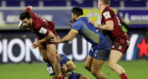 Munster's Damian de Allende is tackled by Camille Lopez and George Moala of Clermont Auvergne during the Champions Cup match at  Stade Marcel-Michelin. Photograph: Laszlo Geczo/Inpho