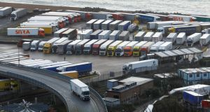 Trucks parked near the Port of Dover in southern England on Tuesday.  The Irish haulage industry wants exemptions from Covid testing for Irish drivers 'transiting' through the UK on their way to mainland Europe.  Photograph: Luke MacGregor/Bloomberg