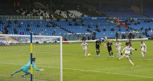 Leeds United's Patrick Bamford scores the winner from the penalty spot during the Premier League match against Burnley at Elland Road. Photo: Nigel French/POOL/AFP via Getty Images