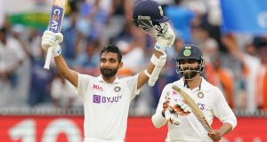 India's  Ajinkya Rahane  celebrates after reaching his century as Ravindra Jadeja applauds  during day two of the second Test Match against  Australia  at the MCG in Melbourne. Photograph: Scott Barbour/EPA