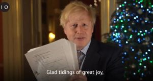 Screengrab taken from the twitter feed of @borisjohnson of the prime minister holding up a document on Christmas Eve believed to be the pages of the Brexit deal. Photograph: @borisjohnson/PA Wire