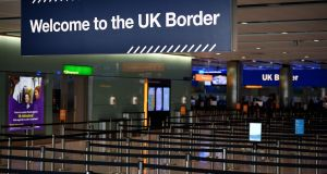 UK border signs are pictured at the passport control in Arrivals in Terminal 2 at Heathrow Airport in London. Photograph: Daniel Leal-Olivas/ AFP via Getty Images