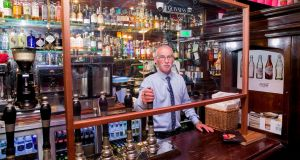 John O Brien, manager of Doheny & Nesbitts on Dublin's Lower Baggot Street, preparing to reopen the pub last June. Photograph: Gareth Chaney/Collins