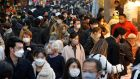 Shoppers wearing protective masks crowd Ameyoko Street in Tokyo, Japan, on December 28th. Photograph: Kimimasa Mayama/EPA