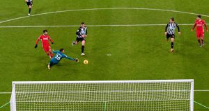Newcastle goalkeeper Karl Darlow saves a shot from Mohamed Salah. Photograph: Stu Forster/PA