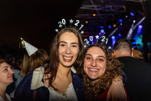 Sophie Jackson and Monique Lee, both from Christchurch, attend New Year celebrations in Hagley Park, Christchurch, New Zealand. New Zealand and its South Pacific island neighbors have no COVID-19, and New Year celebrations there are the same as ever. Photograph : Ernest Kung / AP