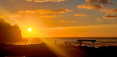 The sun sets at the Piha Surf Club on the west coast beach near Auckland, New Zealand on the last day of 2020. New Zealand is one of the first countries in the world to welcome in the New Year. Photograph : Jacqui Versey/NZ Herald via AP