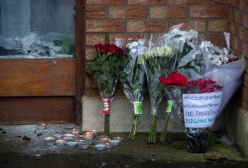 Flowers lay beside bullet holes in the front door of the house on Manorfields Drive, Clonee this evening where George Nknecho was shot dead by Gardai yesterday afternoon. Photograph: Colin Keegan / Collins