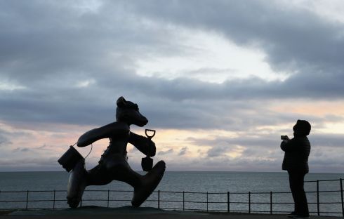 Patrick O'Reilly's Teddy Bear sculpture on the seafront Greystones as morning breaks on New Year's eve in Wicklow.  Photograph: Nick Bradshaw / The Irish Times
