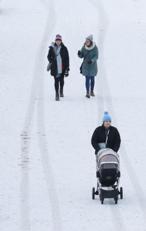 People walking in snow in Lucan, Co Dublin. Photograph: Niall Carson / PA Wire