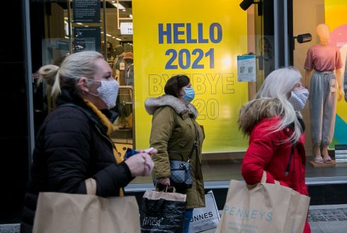 Shoppers pass a 'Hello 2021' sign on Henry Street, Dublin on New Years Eve. Photograph : Gareth Chaney / Collins
