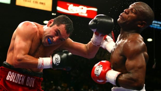Oscar De La Hoya connects with a left to the face of Floyd Mayweather Jr during their WBC super welterweight championship fight at the MGM Grand Garden Arena in Las Vegas on May 5th, 2007. Photograph: Al Bello/Getty Images