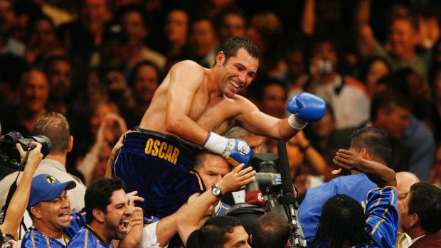 Oscar De La Hoya celebrates his sixth-round TKO of Ricardo Mayorga of Nicaragua, following their WBC super welterweight boxing title match at the MGM Grand in Las Vegas on May 6th, 2006. Photograph: Isaac Brekken/AP