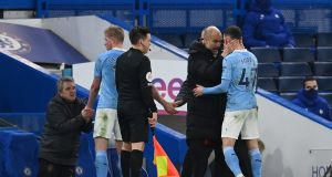 Manchester City manager Pep Guardiola congratulates Phil Foden after being substituted during the Premier League win over Chelsea at Stamford Bridge. Photo: Andy Rain/EPA