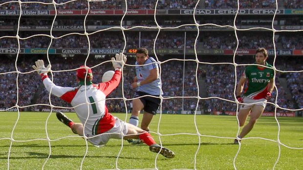 Mayo goalkeeper David Clarke saves from Bernard Brogan of Dublin during the 2012 All Ireland SFC semi-final atCroke Park. Photograph: James Crombie/Inpho